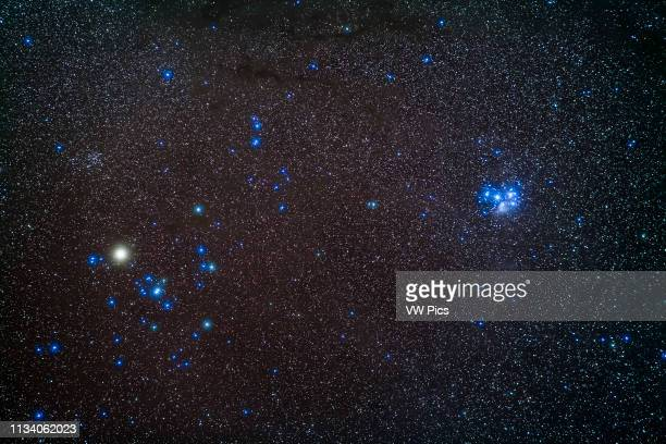 A portrait of the two groups of halfsisters related in mythology as daughters of Atlas the Hyades at left and the blue Pleiades at right two nearby...