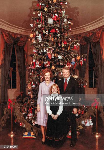 Portrait of the US First Family as they pose in front of the Christmas tree located in the Blue Room of the White House Washington DC December 20...