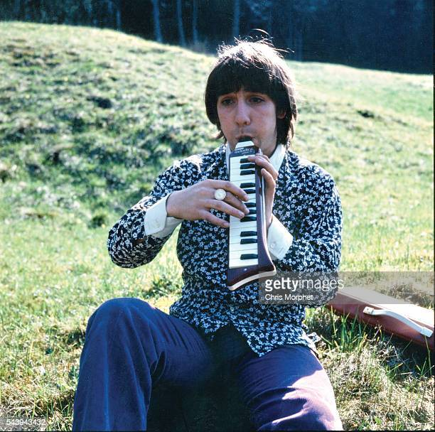Portrait of The Who drummer Keith Moon playing a melodica outdoors during the band's German tour April 1967