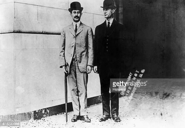 Portrait of the Wright Brothers first to develop powered heavierthanair flight Wilbur stands on the left