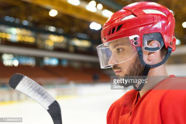 portrait of the young ice hockey player - hockey player stock pictures, royalty-free photos & images