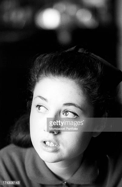 Portrait of the young Italian singer Gigliola Cinquetti with a serene expression while seated in the livingroom of her house Verona January 1965