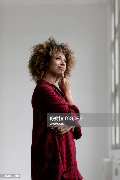 portrait of thinking woman - red blouse stock pictures, royalty-free photos & images