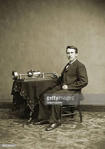 Portrait of Thomas Alva Edison seated with his phonograph invention 187080