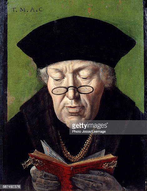 Portrait of Thomas More English humanist wearing glasses and reading a book Painting of the Flemish School 16th century Musee Granet AixenProvence...