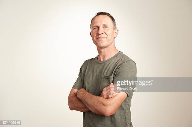 portrait of thoughtful middle-aged man - waist up stock pictures, royalty-free photos & images