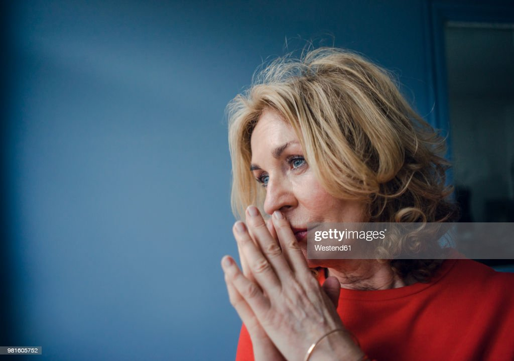 Portrait of thoughtful senior woman : Stock Photo