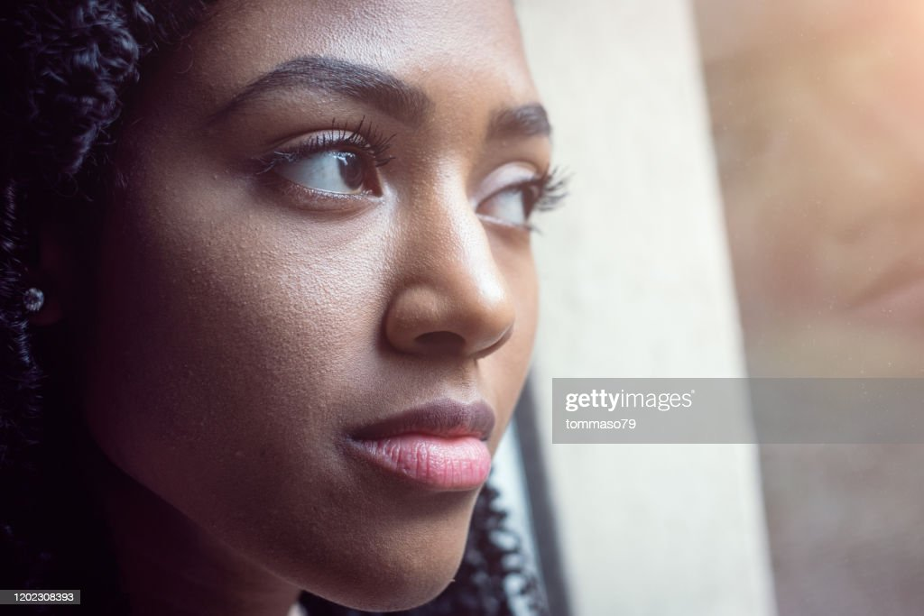 Portrait of thoughtful young black afro american woman : Stock Photo