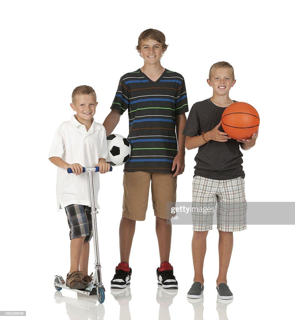 Portrait of three boys smiling : Stock Photo