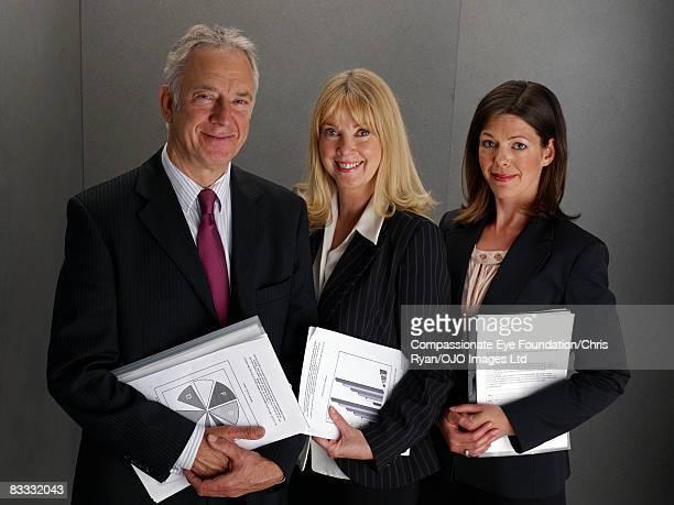 """portrait of three business people - """"compassionate eye"""" - fotografias e filmes do acervo"""