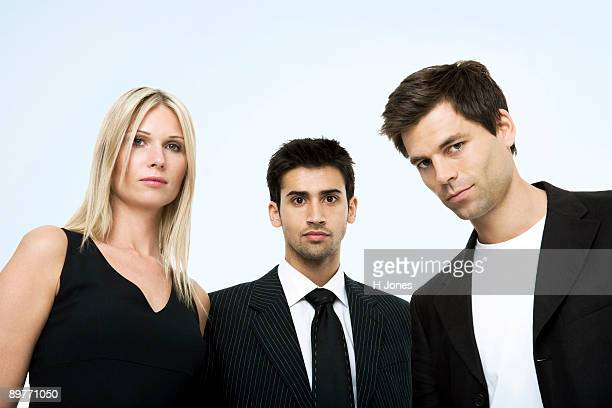 Portrait of three business persons.