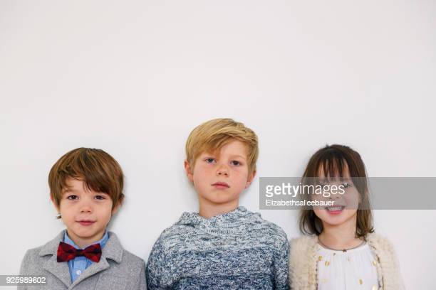 Portrait of three children ready for a party