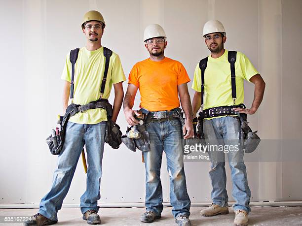 Portrait of three construction workers