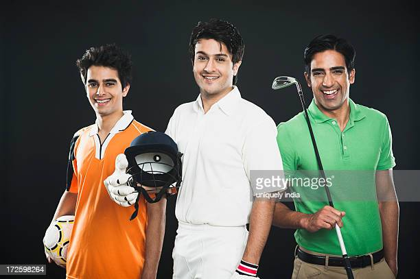 Portrait of three different sportsmen smiling