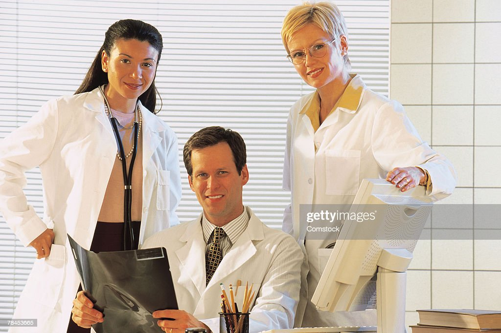 Portrait of three doctors : Stockfoto
