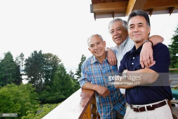 portrait of three elderly men smiling - alleen seniore mannen stockfoto's en -beelden