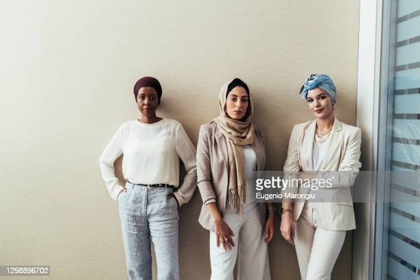 portrait of three female colleagues in office - religious veil stock pictures, royalty-free photos & images