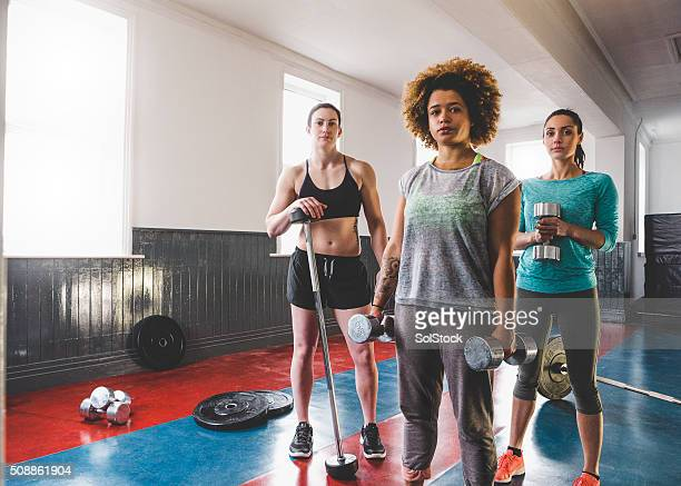 Portrait of Three Female Personal Trainers and Gym Instructors