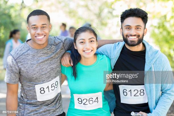 Portrait of three friends before charity race together