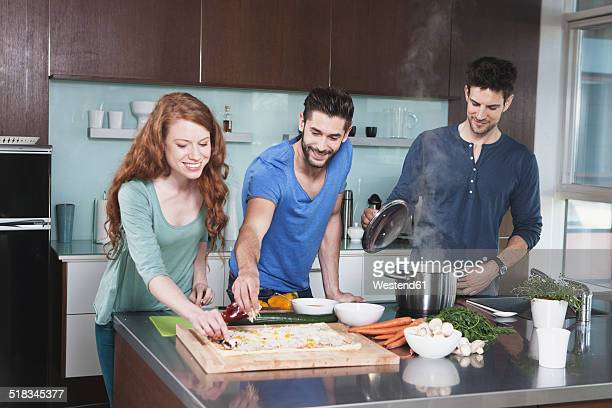 Portrait of three friends cooking together