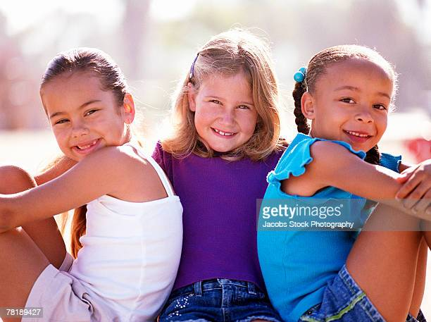 portrait of three friends - girls open legs stock photos and pictures