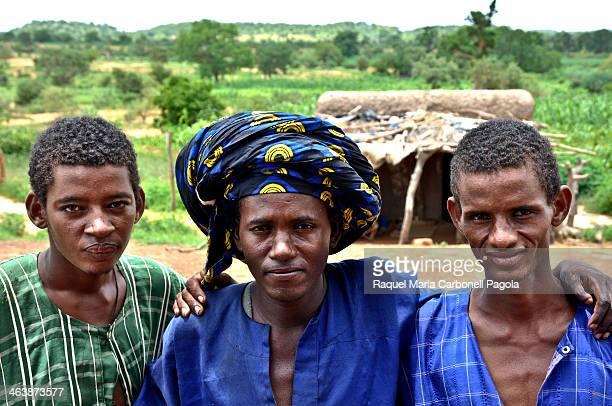 Portrait of three Fulani seminomadic shepherds with traditional clothing