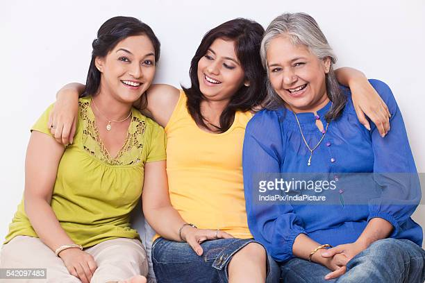 Portrait of three generation family sitting together