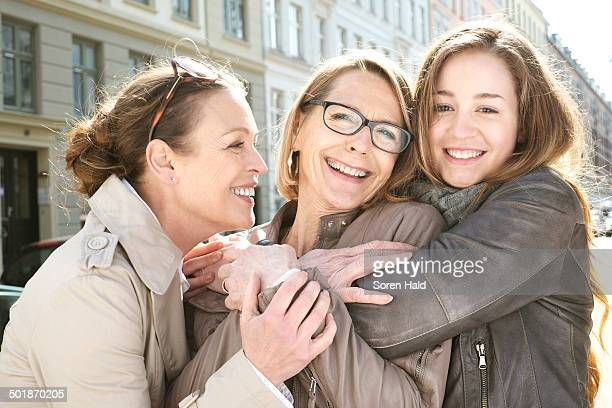 Portrait of three generation females in the city