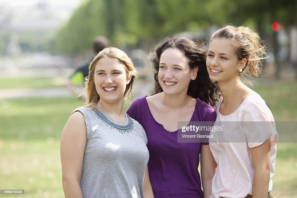 Portrait of three girl in a park : Stock Photo