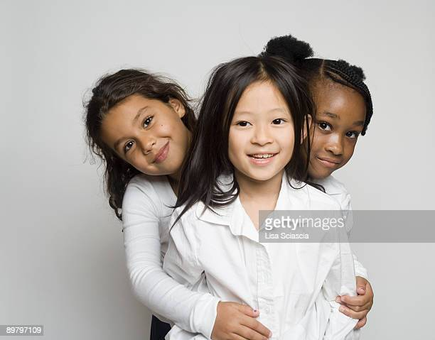 Portrait of three girls embracing each other