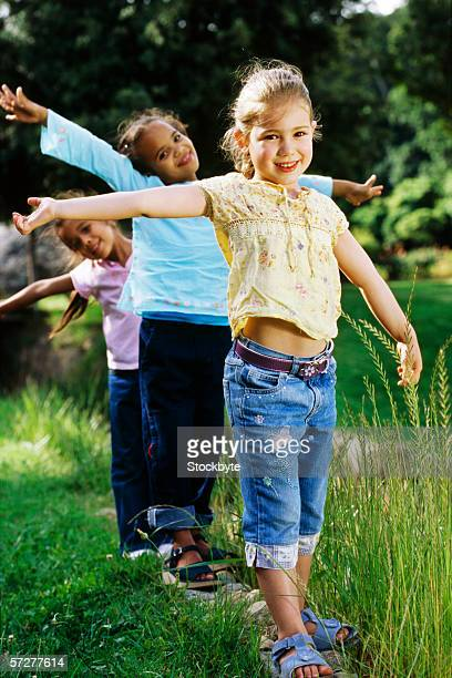 portrait of three girls walking in a row - bermuda shorts stock pictures, royalty-free photos & images