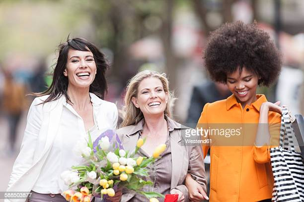 Portrait of three happy women side by side on shopping tour