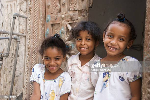 Portrait of three happy young girls.