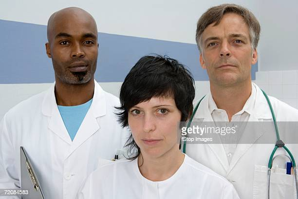 Portrait of three healthcare workers facing camera