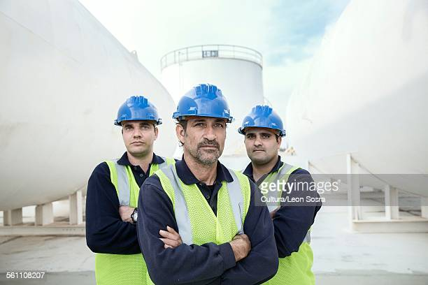 Portrait of three male workers at fuel depot
