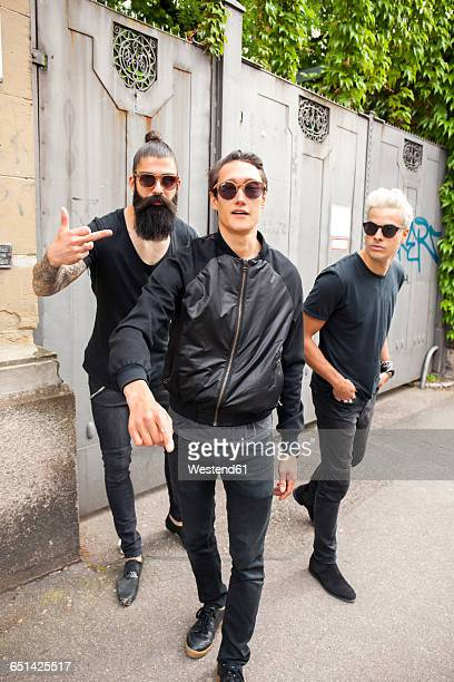 portrait of three man wearing black clothing - black shirt stock pictures, royalty-free photos & images