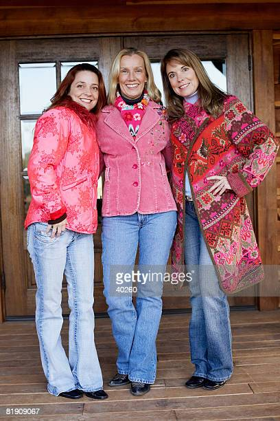 Portrait of three mature women standing together and smiling
