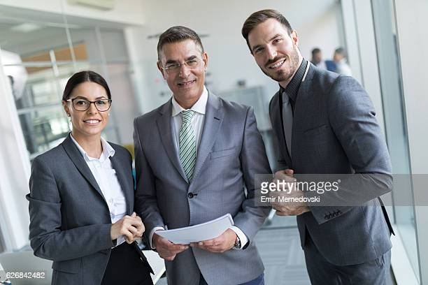 Portrait of  three mixed age business people at work