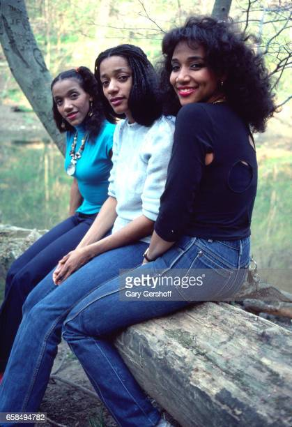 Portrait of three of the sibling Soul and Disco group Sister Sledge as they pose outdoors Philadelphia Pennsylvania April 28 1981 Pictured are from...