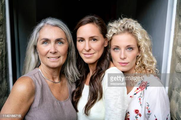 portrait of three smiling women of different age - sólo con adultos fotografías e imágenes de stock