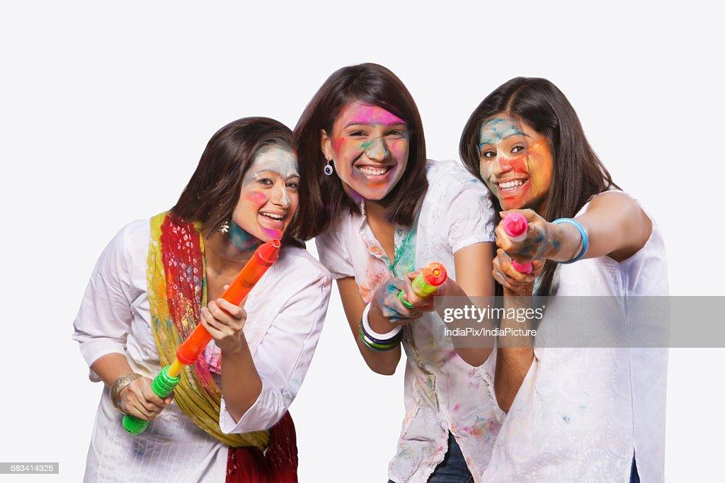 Portrait of three women playing holi : Stock Photo