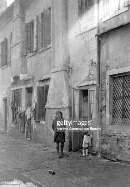 Portrait of three young girls outside their home Venice Italy 1946