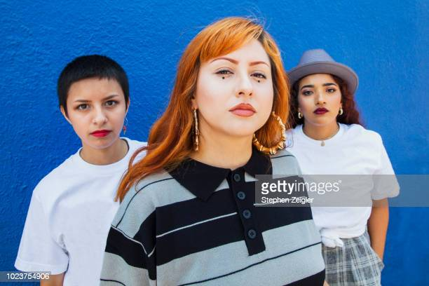 portrait of three young latina women - coraggio foto e immagini stock