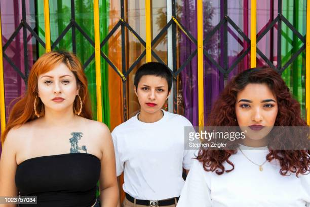Portrait of three young Latina women