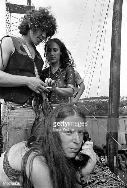 A portrait of three young people at the Woodstock Music Art Fair Bethel NY August 15 1969