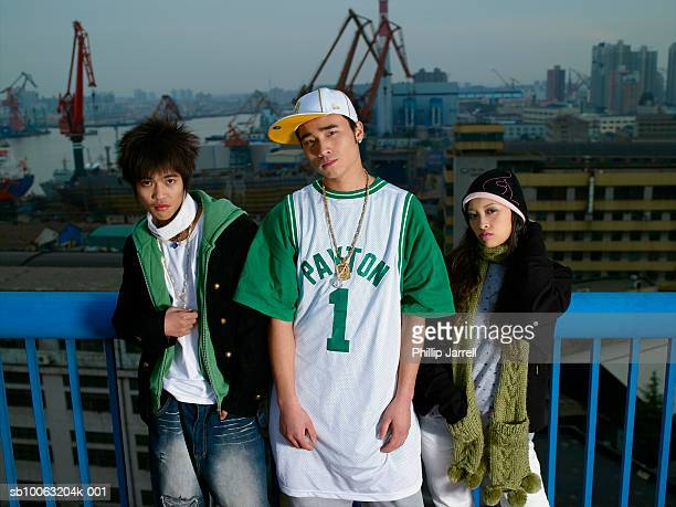 portrait of three young people including teenager (16-17) in dock - chav stock photos and pictures