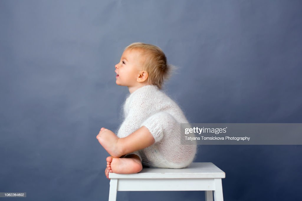 Portrait of toddler baby boy, playing on isolated background, smiling from happines : Stock Photo