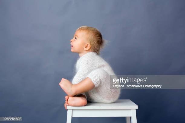portrait of toddler baby boy, playing on isolated background, smiling from happines - chest kissing stock pictures, royalty-free photos & images