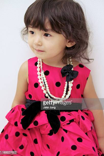 Portrait of toddler girl in formal clothes