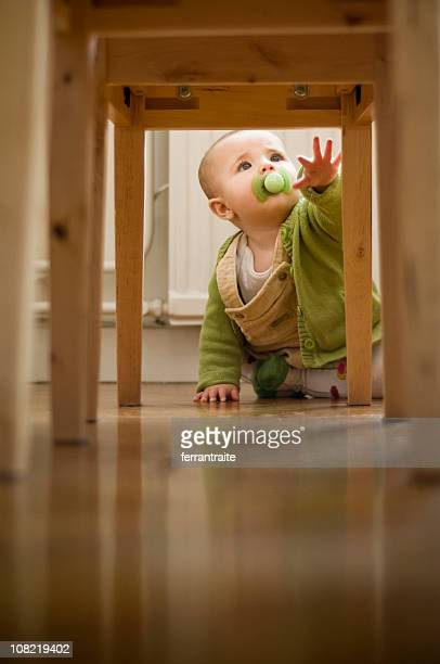 Portrait of Toddler on Floor Reaching Up